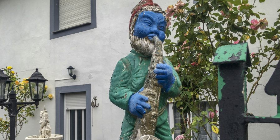 Blue gnome playing saxophone